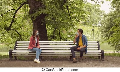 Young, happy, loving couple having date on the bench in the ...