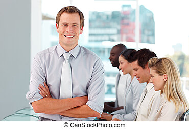 Happy Male Boss leading his team - Young Happy Male Boss...