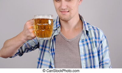 Young happy man tasting a draft beer - Young man tasting a...