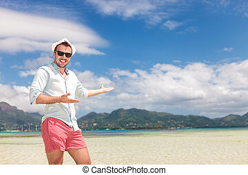 happy man welcomes you to the sunny beach