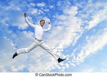 men jumping against blue sky