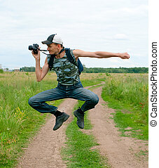 happy men jumping and photographing