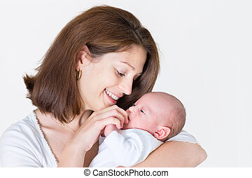 Young happy mother holding her newborn baby