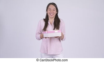 Young happy multi-ethnic businesswoman holding gift box -...