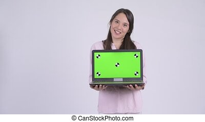 Young happy multi-ethnic businesswoman showing laptop -...