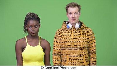 Young happy multi-ethnic couple together - Studio shot of...