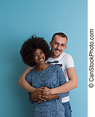 multiethnic couple laughing and hugging