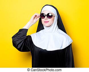 Young happy nun with sunglasses