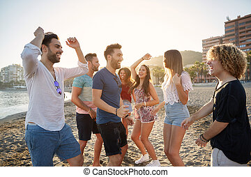 Young Happy People Partying On Beach