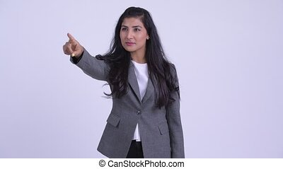 Young happy Persian businesswoman directing and pointing...