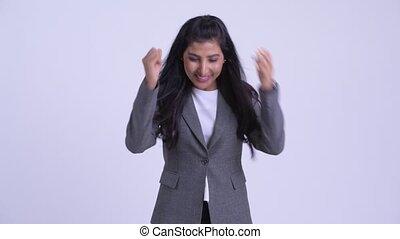 Young happy Persian businesswoman getting good news - Studio...
