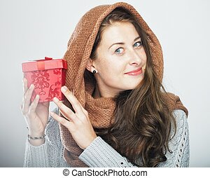 playful cute winter girl with gift box