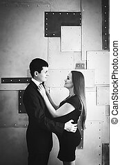 Young happy pregnant couple. Black and white.