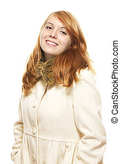 young happy redhead woman in fawn winter coat on white background