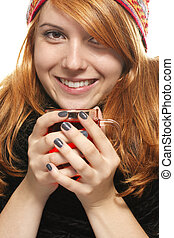young happy redhead woman in winter dress with tea on white background