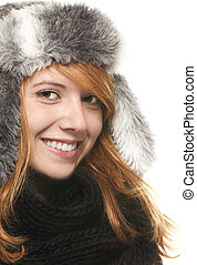 young happy redhead woman with a winter cap on white background
