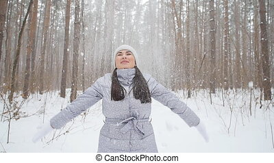 Young happy smile woman throws snow