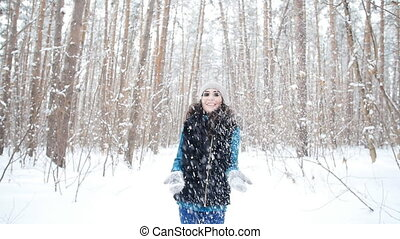 Young happy smile woman throws snow - Young happy smile Girl...