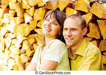 Young happy smiling attractive couple together outdoors
