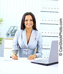Young happy smiling businesswoman working at office