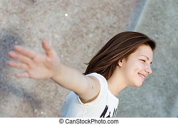 Young happy smiling teenage girl
