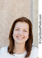 Young happy smiling teenage girl portrait