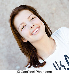 Young happy smiling teenage girl portrait