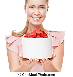 Young happy smiling woman with a gift in hands. Focus on the gif
