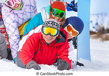 Young happy snowboarders portrait