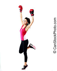 Young happy sports woman standing in boxing gloves over white background