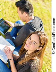 Young Happy Student Studying