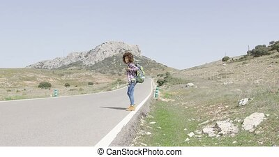 Young happy tourist - Young female traveler with walking...