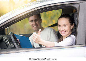 Young happy woman and man in the car