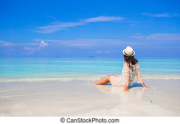 Young happy woman enjoy summer vacation on white sandy beach...