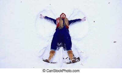 Young happy woman having fun on snow
