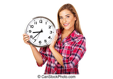Young happy woman holding a clock