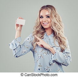 Young happy woman holding credit card