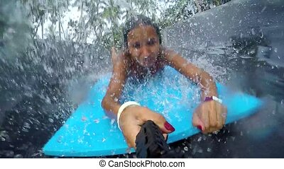 Young happy woman holds Go Pro action camera jumps in the ...
