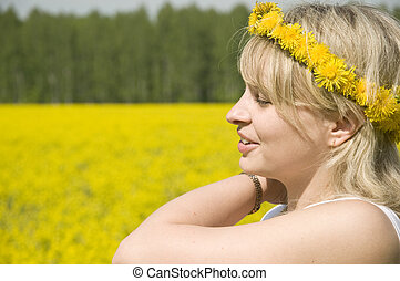 Young happy woman in field