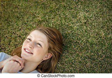 Young happy woman in grass