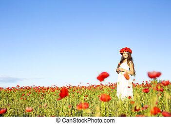 Young happy woman in poppy field