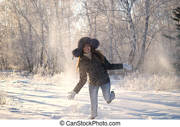 young happy woman in snowdrift