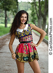 Young happy woman in summer dress