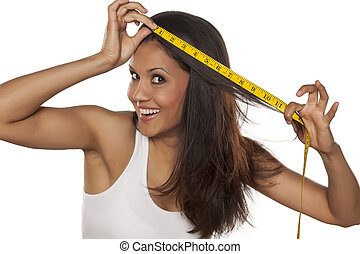 Young happy woman measured her hair