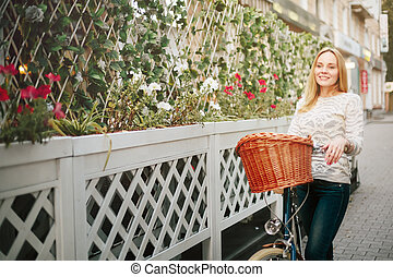 Young Happy Woman on a Vintage Bicycle