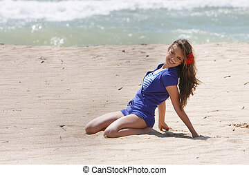 young happy woman on beach