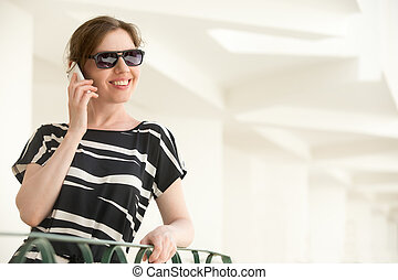 Young happy woman on phone