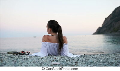 Young happy woman on the european beach in Monterosso, Cinque Terre in Italy