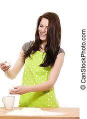 young happy woman preparing eggs for baking with flour on white background