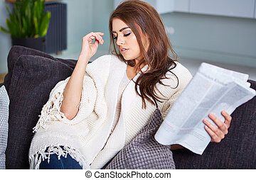 Young Happy Woman Reading Newspaper